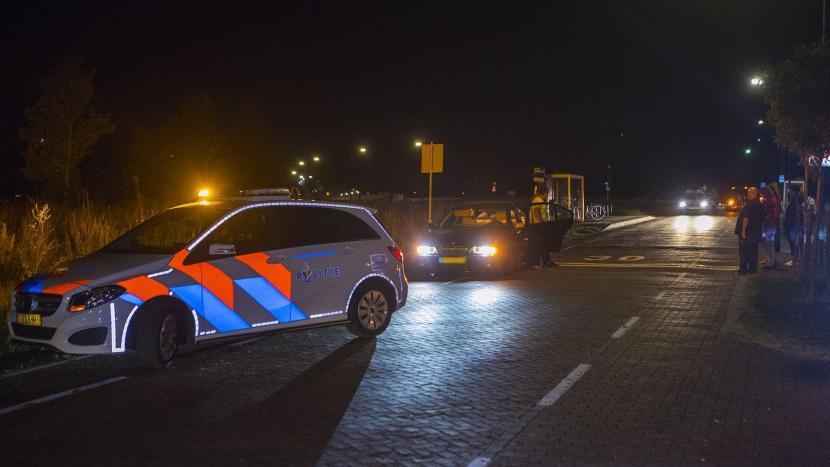 Een politie auto bij hij ongeluk op de Sonseweg